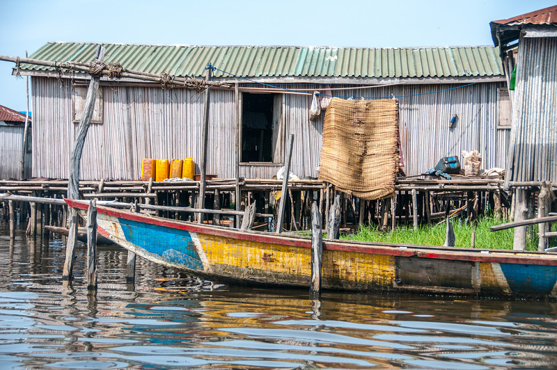 House and boat in fishing village in Cotonou, Benin