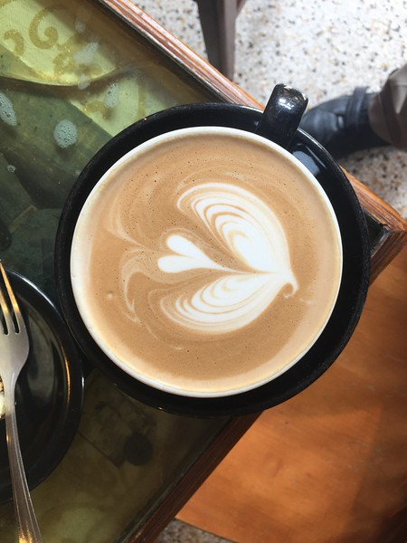 Latte served with a flourish