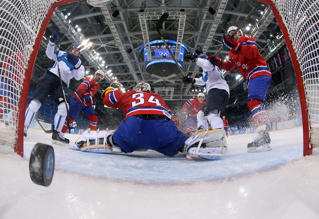 . Finland\'s Olli Maatta (2nd R) scores a goal during the Men\'s Ice Hockey Group B match Norway vs Finland at the Shayba Arena during the Sochi Winter Olympics on February 14, 2014. Finland won 1-6. AFP PHOTO / POOL / Martin Rose/AFP/Getty Images