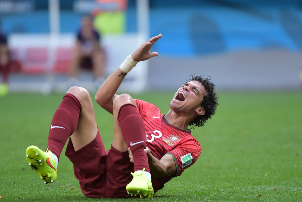 . Portugal\'s defender Pepe reacts during the Group G football match between Portugal and Ghana at the Mane Garrincha National Stadium in Brasilia during the 2014 FIFA World Cup on June 26, 2014.  (GABRIEL BOUYS/AFP/Getty Images)