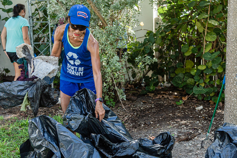 Andrea McMillian, a resident of West Palm Beach for 40 years, gathers trash at the Currie Park Marina in West Palm Beach, Sunday, October 11, 2020. McMillan, along with a group of volunteers is doing their part to clean up to try and clean up the pervasive litter problem in West Palm Beach. (JOSEPH FORZANO / THE PALM BEACH POST)