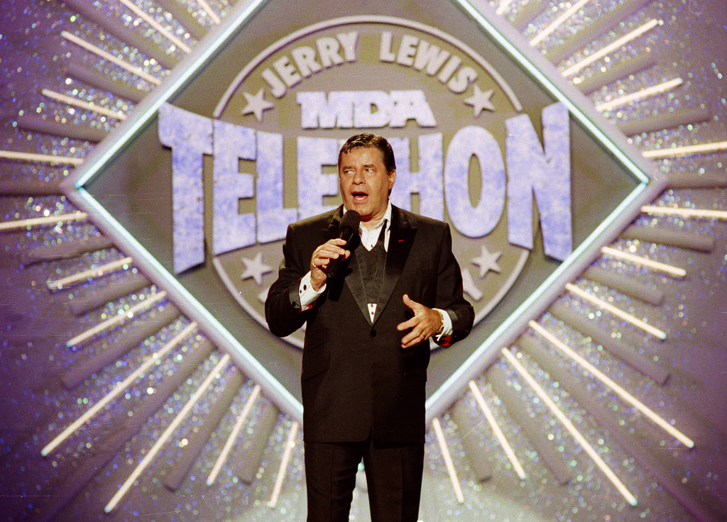 . FILE - In this Sept. 2, 1990, file photo, entertainer Jerry Lewis makes his opening remarks at the 25th Anniversary of the Jerry Lewis MDA Labor Day Telethon fundraiser in Los Angeles. Lewis, the comedian and director whose fundraising telethons became as famous as his hit movies, has died. Publicist Candi Cazau said Lewis passed away Sunday, Aug. 20, 2017, at age 91 in Las Vegas with his family by his side.  (AP Photo/Julie Markes, File)