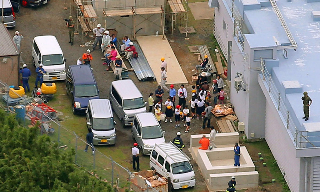 . Evacuees gather at a shelter after Mount Shindake erupted on Kuchinoerabu island, southern Japan, Friday, May 29, 2015. The volcano erupted in spectacular fashion on the small island on Friday, spewing out rocks and sending black clouds of ash 9 kilometers (5.6 miles) into the sky. Authorities told people on the island to evacuate. (Kyodo News via AP)