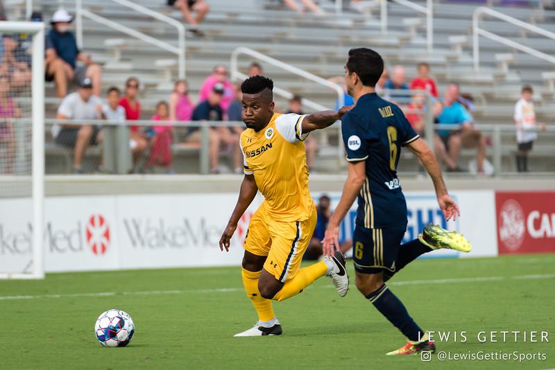 Nashville SC defender Bradley Bourgeois (22) and North Carolina FC midfielder Austin da Luz (6)