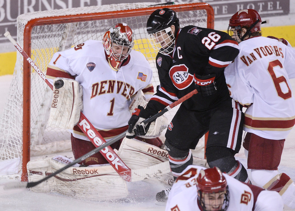 . DENVER, CO. - JANUARY 10: Huskies\' center Nic Dowd (26) pressured Denver goalie Sam Brittain (1) in the second period. The University of Denver hockey team hosted St. Cloud State at Magness Arena Friday night, January 10, 2014. Photo By Karl Gehring/The Denver Post