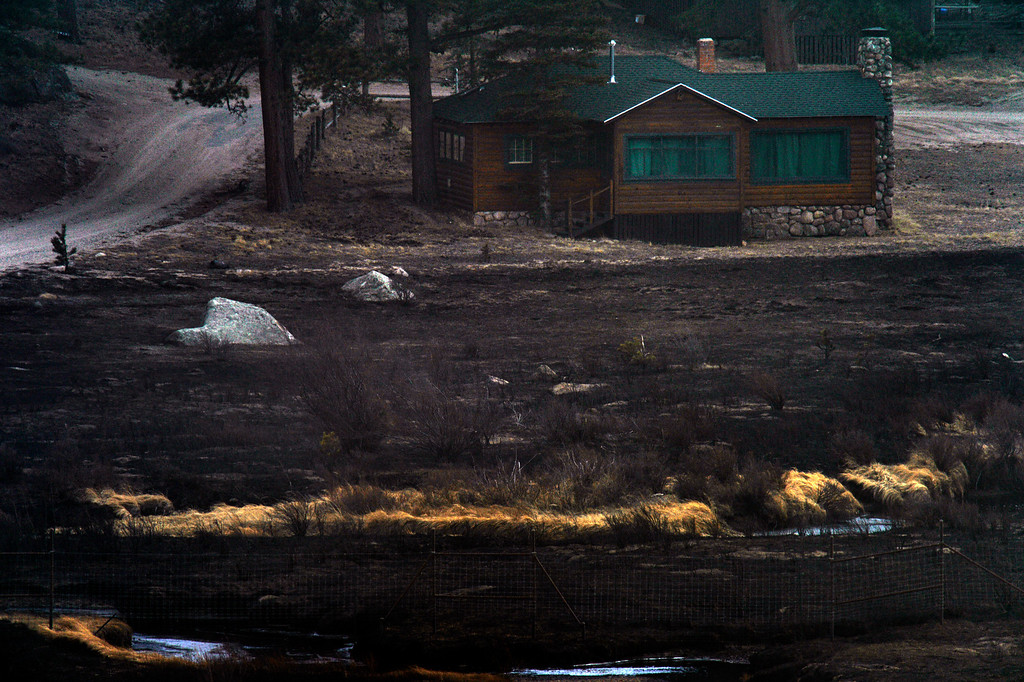 . This home was spared inn the open area where the Fern Lake fire rushed 3 miles in 35 minutes at Historic Moraine Park in the  Rocky Mountain National Park, in Colorado Monday, December 3,  2012.    Joe Amon, The Denver Post