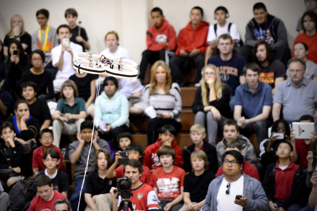 ". A quad copter flies as a crowd of school children watch mechanical engineering Caltech students compete in the annual ME72 Engineering Design Contest at the Pasadena campus Tuesday, March 11, 2014. The goal in ""Raiders of the Lost Can\"" was to move their team\'s can closest to the center of a platform. (Photo by Sarah Reingewirtz/Pasadena Star-News)"
