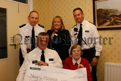 The PSNI present a cheque for £12.050.00 for the Hospice , Included are Inspector D Beck, Sergeant  Bingham and Chief Superintendent  B Hunniford, Fiona Stephens and Sister Clare (hospice). 07W7N57