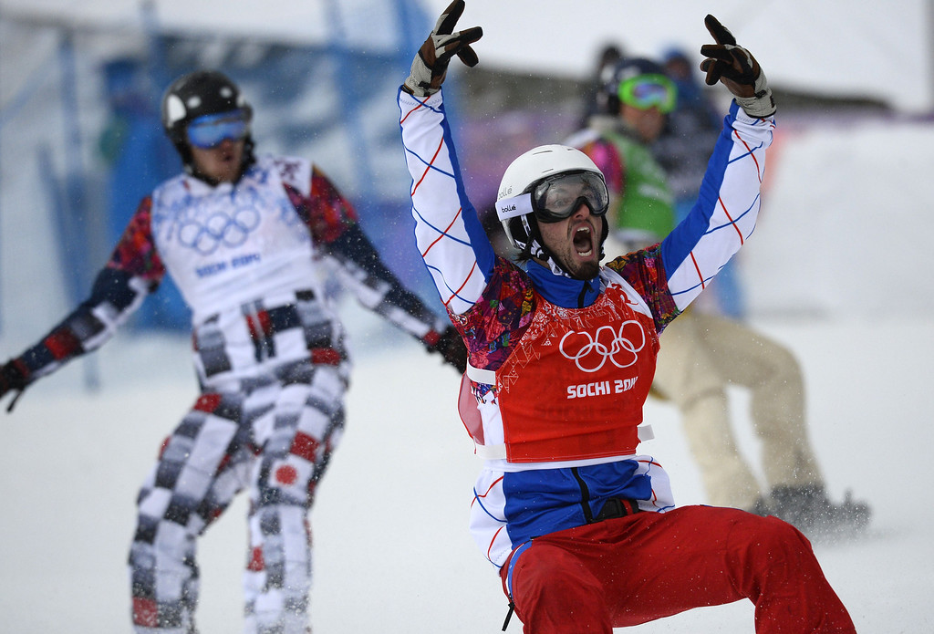 . France\'s Pierre Vaultier celebrates his Gold Medal ahead of Russia\'s Nikolay Olyunin (L) and US Alex Deibold (R)in the Men\'s Snowboard Cross Final at the Rosa Khutor Extreme Park during the Sochi Winter Olympics on February 18, 2014.    AFP PHOTO / LIONEL  BONAVENTURE/AFP/Getty Images