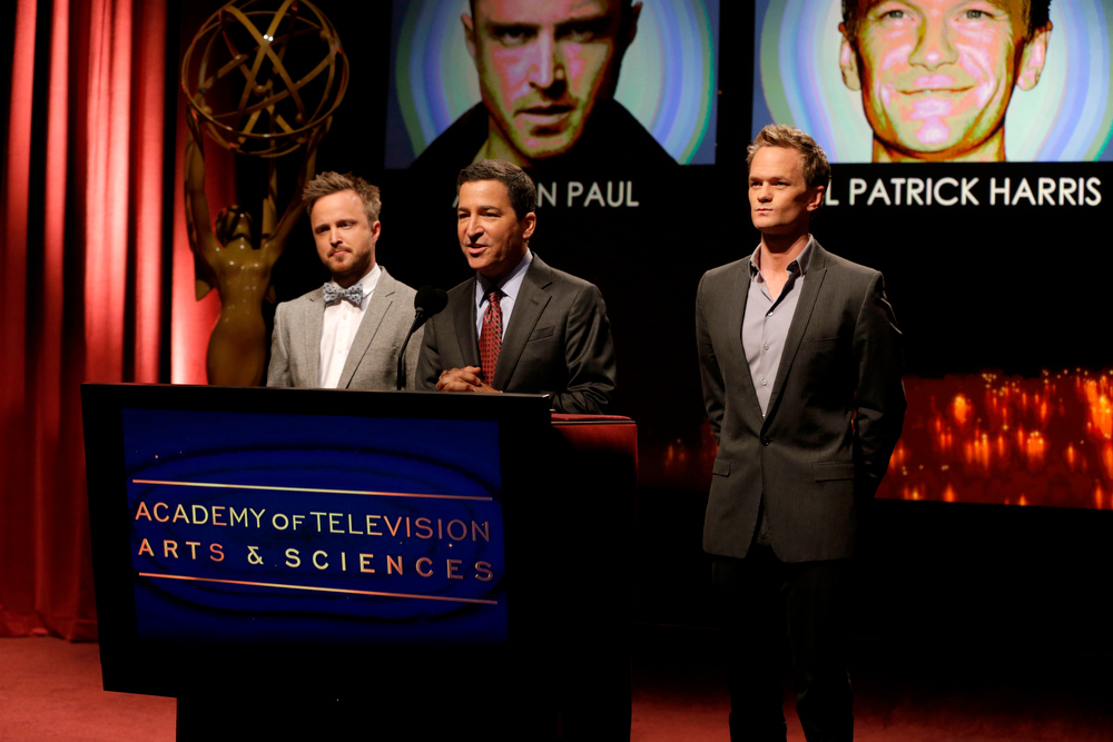 . Actor Aaron Paul, left, Academy of Television Arts & Sciences Chairman and CEO Bruce Rosenblum, center, and actor Neil Patrick Harris announce nominations at the 65th Primetime Emmy Nominations Announcements at the Leonard H. Goldenson Theatre at the Academy of Television Arts & Sciences, Thursday, July 18, 2013 in North Hollywood, Calif. (Photo by Todd Williamson/Invision/AP)