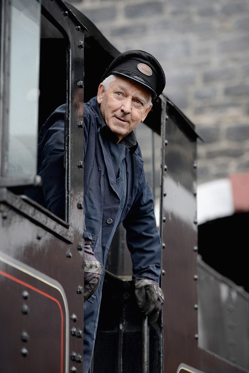 . Fireman Ken Plant looks from the plate of a 1952 British Rail Ivatt number 46512 at Strathspey Steam Railway on August 27, 2013 in Aviemore,Scotland.   (Photo by Jeff J Mitchell/Getty Images)