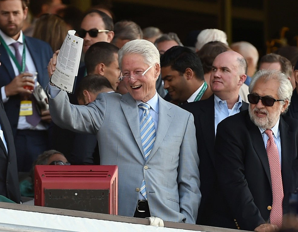 . Former US President Bill Clinton watches American Pharoah ridden by Victor Espinoza  as he wins the 147th Belmont Stakes at Belmont Park on June 6, 2015 in Elmont, New York. American Pharoah ended US racing\'s 37-year Triple Crown drought on Saturday with a convincing victory in the Belmont Stakes.  AFP PHOTO / TIMOTHY A.  CLARY/AFP/Getty Images
