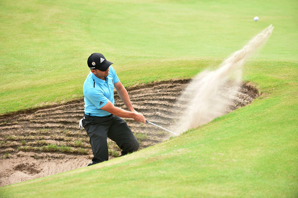. Spain\'s Sergio Garcia plays from a bunker on the 17th green during his fourth round 66, on the final day of the 2014 British Open Golf Championship at Royal Liverpool Golf Course in Hoylake, north west England on July 20, 2014.   PAUL ELLIS/AFP/Getty Images