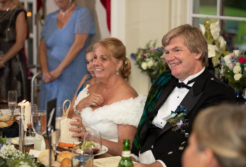Bride and Groom Listening to Speeches.jpg
