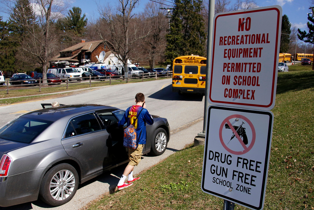 . A student leave the campus of the Franklin Regional School District after more then a dozen students were stabbed by a knife wielding suspect at nearby Franklin Regional High School on Wednesday, April 9, 2014, in Murrysville, Pa., near Pittsburgh. The suspect, a male student, was taken into custody and is being questioned. (AP Photo/Gene J. Puskar)