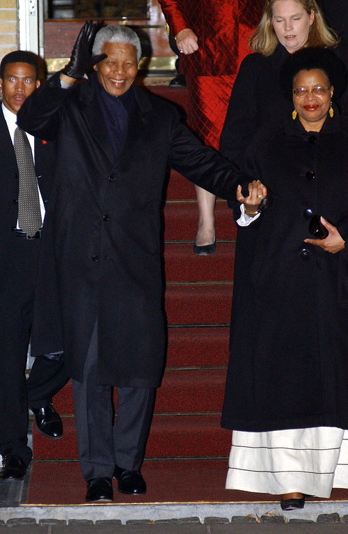 . Nelson Mandela and his wife are on the way to wedding celebrations February 1, 2002 in Amsterdam, Netherlands for Dutch Crown Prince Willem Alexander and Argentine Maxima Zorreguieta. Maxima and Willem Alexander will marry February 2, 2002.  (Photo by Anthony Harvey/Getty Images)