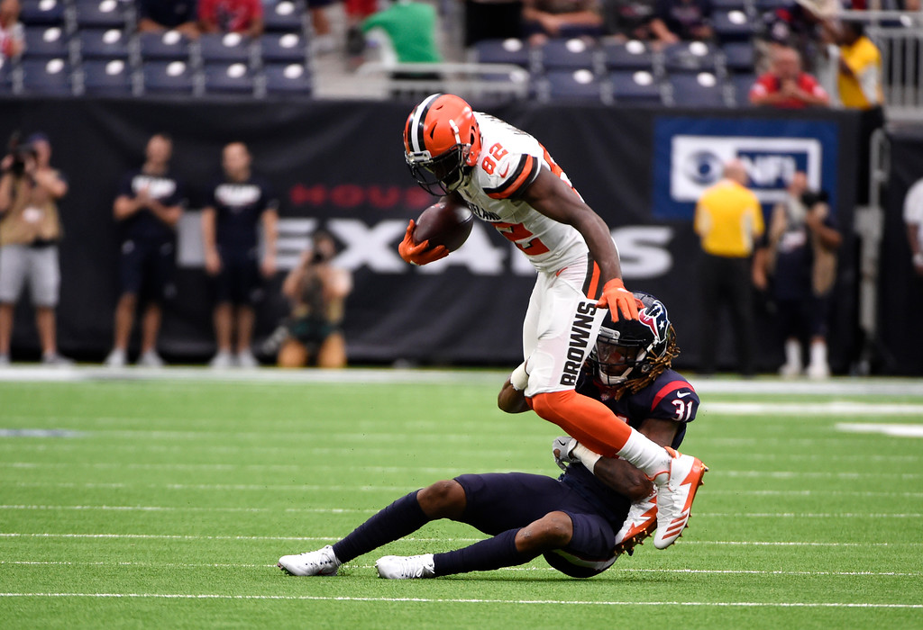 . Cleveland Browns wide receiver Kasen Williams (82) is stopped by Houston Texans cornerback Treston Decoud (31) after catching a pass in the second half of an NFL football game, Sunday, Oct. 15, 2017, in Houston. (AP Photo/Eric Christian Smith)