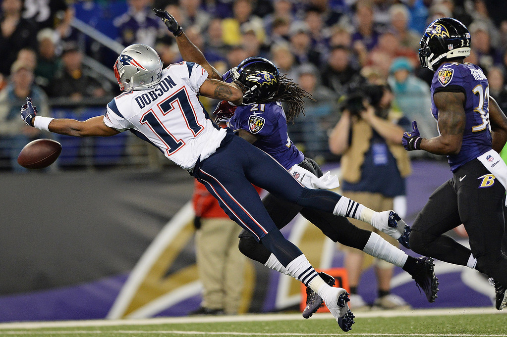 . Wide receiver Aaron Dobson #17 of the New England Patriots misses a catch against the Baltimore Ravens in the third quarter at M&T Bank Stadium on December 22, 2013 in Baltimore, Maryland. The New England Patriots won, 41-7. (Photo by Patrick Smith/Getty Images)