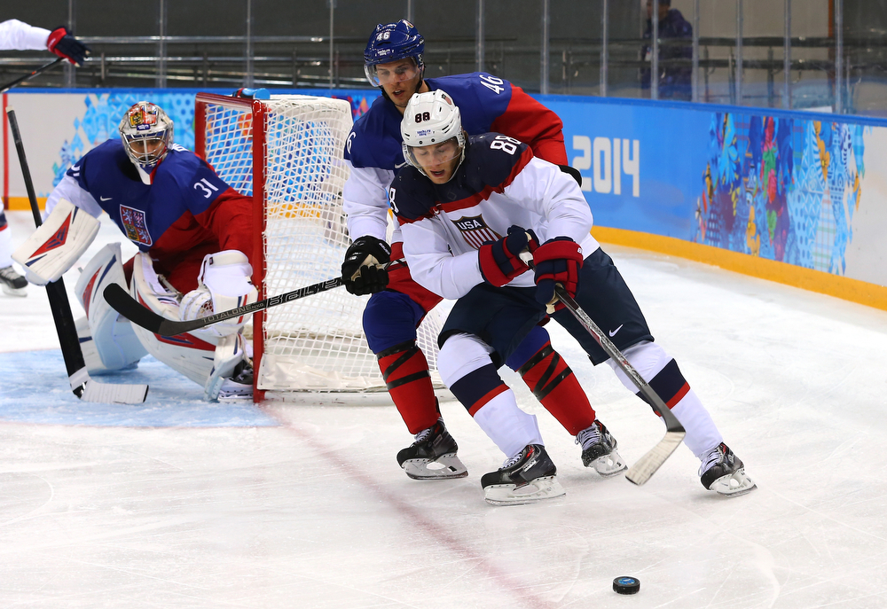. Patrick Kane #88 of the United States skates against David Krejci #46 of the Czech Republic during the Men\'s Ice Hockey Quarterfinal Playoff on Day 12 of the 2014 Sochi Winter Olympics at Shayba Arena on February 19, 2014 in Sochi, Russia.  (Photo by Martin Rose/Getty Images)
