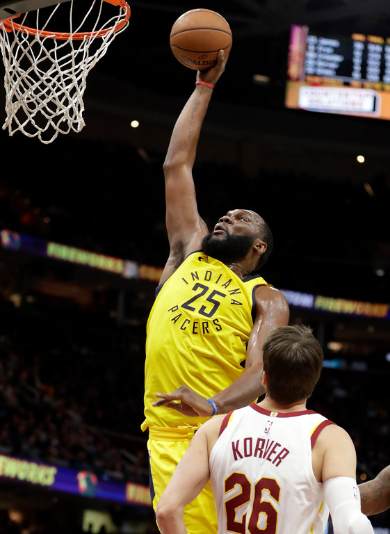 . Indiana Pacers\' Al Jefferson (25) dunks the ball against Cleveland Cavaliers\' Kyle Korver (26) in the second half of an NBA basketball game, Friday, Jan. 26, 2018, in Cleveland. (AP Photo/Tony Dejak)