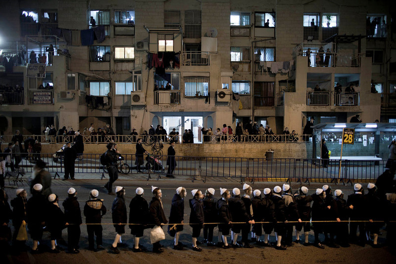 . Ultra Orthodox Jews belonging to the Satmar Hasidic group headed by Satmar  Admor of Williamsburg, Rabbi Zalman Leib Teitelbaum, wait for his arrival in the Ultra Orthodox Jewish neighborhood of Mea Shearim in Jerusalem, Sunday, Jan. 20, 2013. (AP Photo/Oded Balilty)