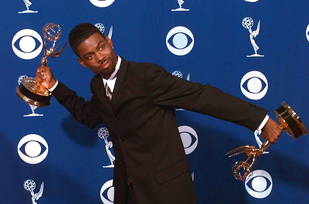 """. Chris Rock clowns around holding his awards for outstanding writing for a variety or music program and outstanding variety music or comedy special for \""""Chris Rock:Bring the Pain\"""" at the 49th Annual Primetime Emmy Awards, Sunday Sept. 14, 1997 in Pasadena, Calif. (AP Photo/Kevork Djansezian)"""