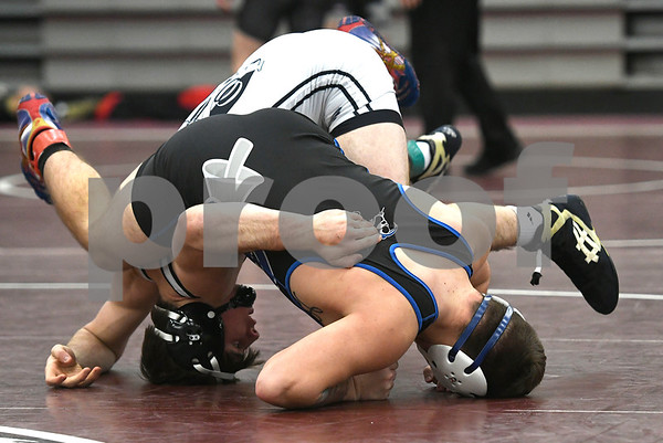 1/6/2018 Mike Orazzi | Staff Bristol Eastern's Dylan Levesque and Xavier's Ryan DeVivo in a 170 match during the Bristol Central High School Invitational wrestling match Saturday in Bristol.