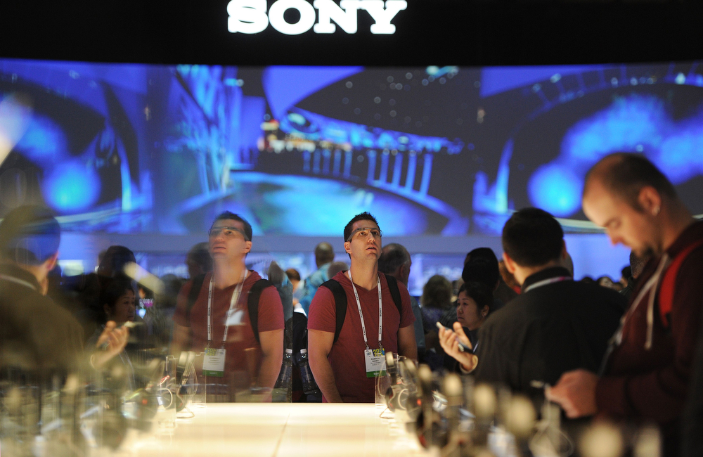 Description of . Attendees visit the Sony booth, on the final day of the 2014 International CES, January 10, 2014 in Las Vegas, Nevada. (Robyn Beck/AFP/Getty Images)