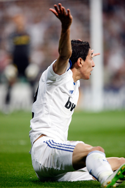 Di Maria claiming a foul sitting on the ground, UEFA Champions League Semifinals game between Real Madrid and FC Barcelona, Bernabeu Stadiumn, Madrid, Spain