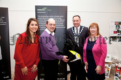 Volunteer Now, the lead organisation for volunteering in Northern Ireland, has launched Volunteering – Faces and Places, an exhibition which captures the diversity of people from across Northern Ireland involved in a variety of volunteering roles.  The exhibition is visiting various Libraries across Northern Ireland and was visited in Newry Library by the Mayor, Councillor Michael Ruane. Pictured with the Mayor is Exhibitor David McClurg with his dog  Gibson, Rachel Rodrigues-Keenan and Rosmary Loughran. R1404001
