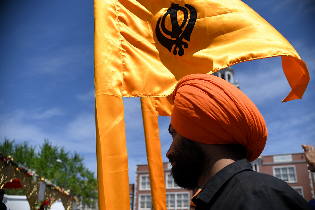 . DENVER, CO - MAY 22: Dhanwand Sidhu holds a Sikh flag before walking in a parade on Sunday, May 22, 2016. This was Denver\'s first ever Sikh parade. The event was held to celebrate the culture of the growing Sikh population in the area. (Photo by AAron Ontiveroz/The Denver Post)