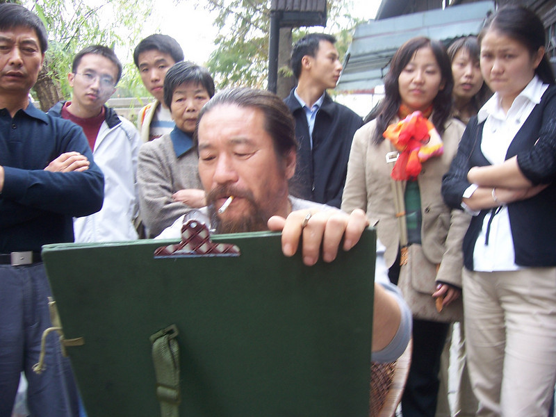 Interested bystanders while artist is doing my portrait  in Zhu Jia Jiao, nr Shanghai