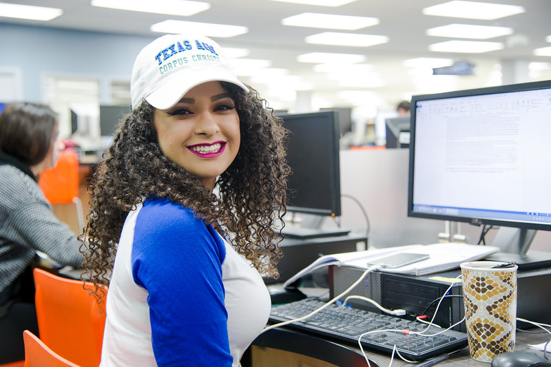 Student Jaclyn Maldonado shows islander spirit in the Mary and Jeff Bell Library.
