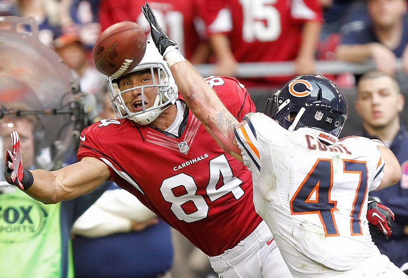 . Arizona Cardinals tight end Rob Housler (84) tries to pull in a pass as Chicago Bears free safety Chris Conte (47) defends during the first half of an NFL football game, Sunday, Dec. 23, 2012, in Glendale, Ariz. (AP Photo/Paul Connors)