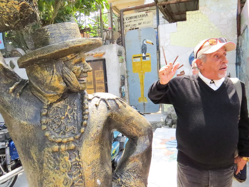 Victor shows us this sculpture has the genuine teeth of a former community resident.