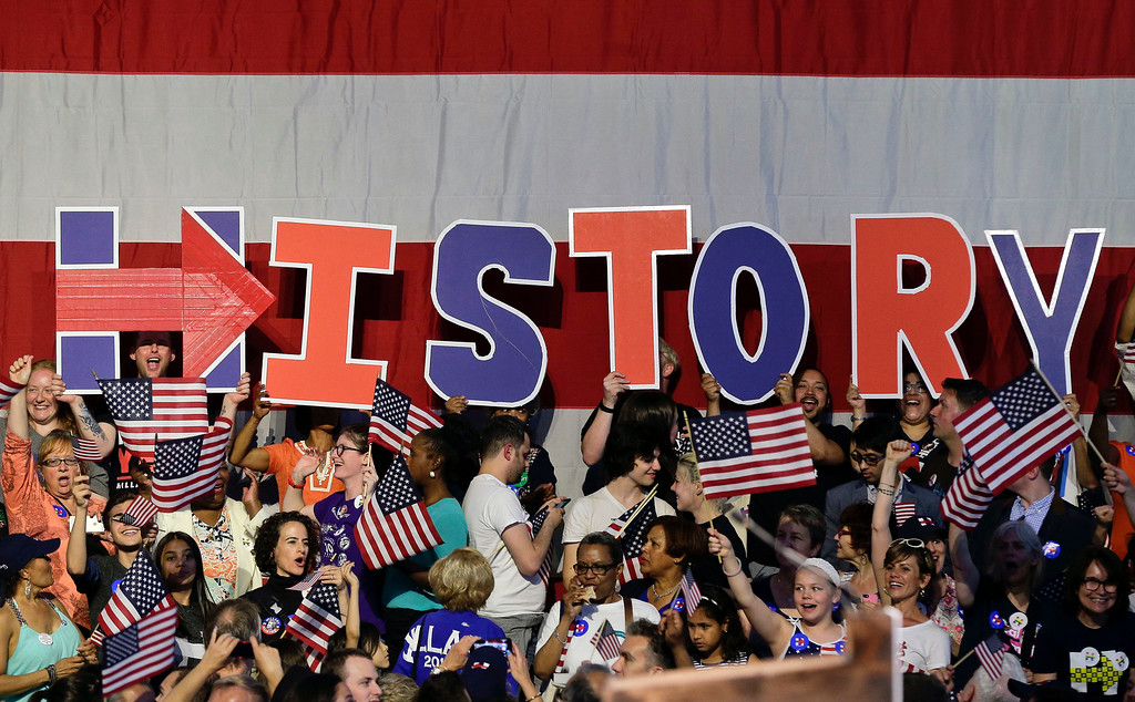 . Supporters for Democratic presidential candidate Hillary Clinton hold up letters to spell the word, history, during a presidential primary election night rally, Tuesday, June 7, 2016, in New York.  (AP Photo/Julie Jacobson)