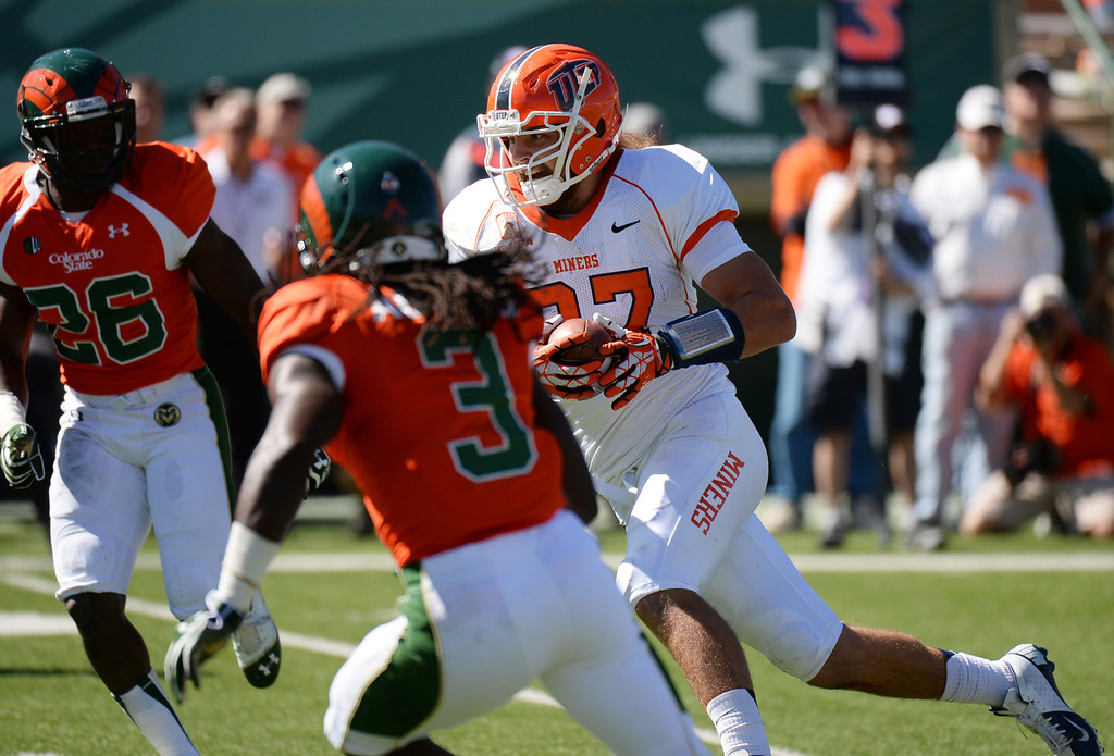 . FORT COLLINS, CO - September 28 : Eric Tomlinson of University of Texas at El Paso (87), rushes against Colorado State University defense in the 1st half of the game at Hughes Stadium. Fort Collins, Colorado. September 28, 2013. (Photo by Hyoung Chang/The Denver Post)