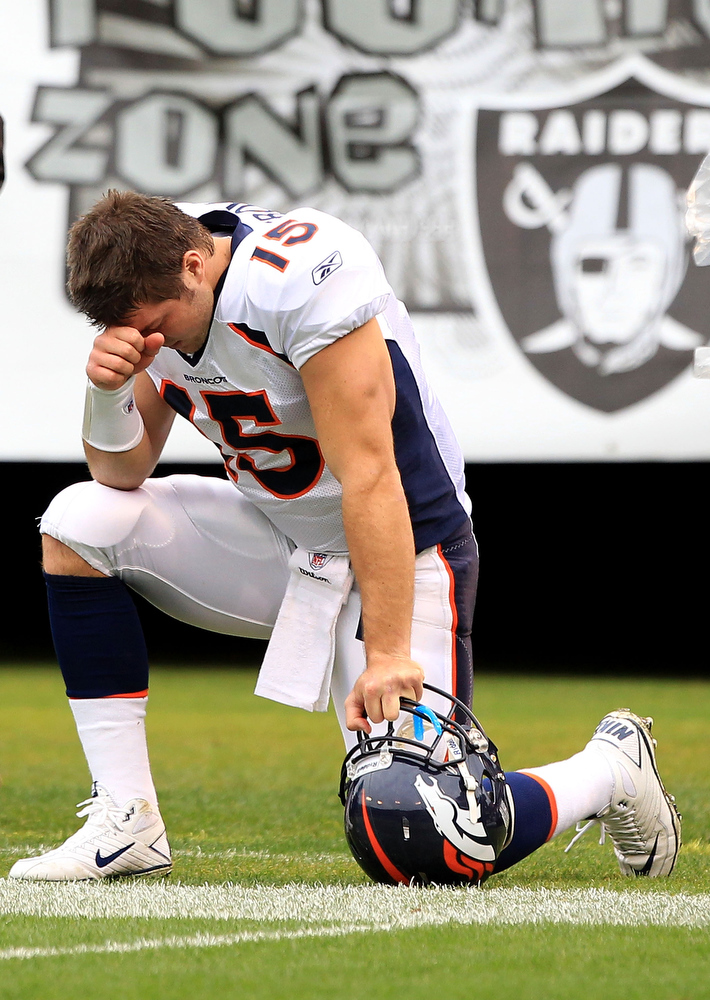 . Tim Tebow, Florida Selected 25th overall by the Broncos in 2010 Expected to fall to the second or third round in the 2010 draft, the Broncos took a chance by selecting Tebow and his unconventional throwing method in the first round. He proceeded to enjoy a storybook 2011 season, even leading the Broncos to a playoff win over the Steelers. The ensuing postseason, Denver signed Peyton Manning and traded Tebow to the Jets , where he spent much of the season running gimmick plays or standing on the bench. His NFL future is now unclear. GRADE: F. Using a first-round pick on him looked back on draft night, and it looks even worse now. (Photo by Ezra Shaw/Getty Images)