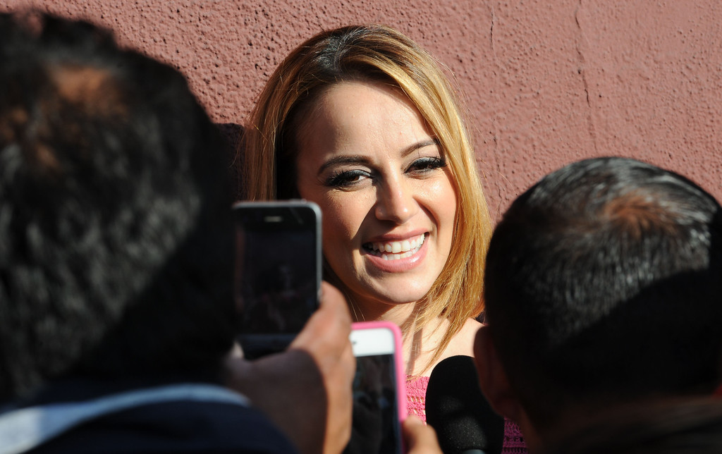 . Dec. 9 marks the one year anniversary of the death of singer Jenni Rivera. Jenni\'s sister Rosie Rivera talk with fans outside the Jenni Rivera Boutique in Panorama City. Fans were on hand for the release of her new live album, which was recorded just before Jenni\'s death in a  plane crashed in Mexico.  Panorama City Calif., December 3, 2013. 