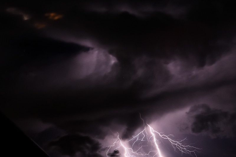 Break from light trails for a lucky partial shot of lightning.