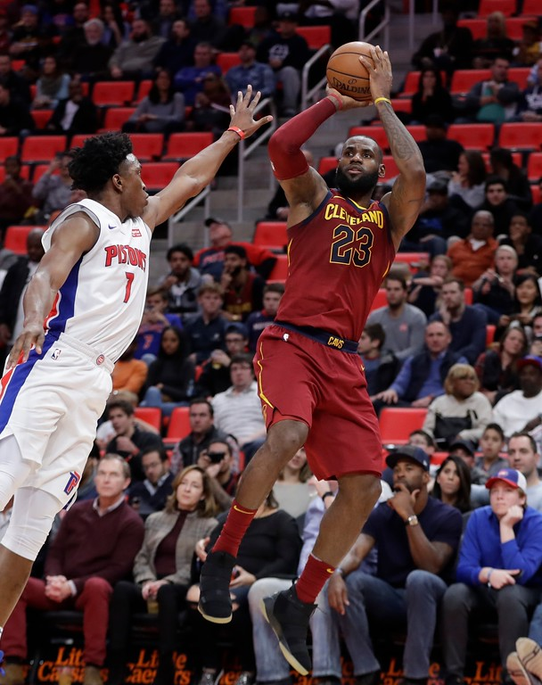 . Cleveland Cavaliers forward LeBron James (23) shoots over Detroit Pistons forward Stanley Johnson (7) during the second half of an NBA basketball game, Monday, Nov. 20, 2017, in Detroit. (AP Photo/Carlos Osorio)
