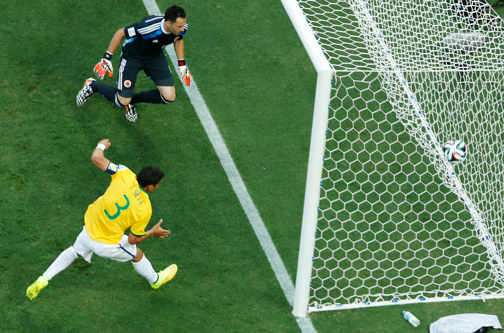 . Brazil\'s defender and captain Thiago Silva (bottom) scores during the quarter-final football match between Brazil and Colombia at the Castelao Stadium in Fortaleza during the 2014 FIFA World Cup on July 4, 2014. FABRIZIO BENSCH/AFP/Getty Images