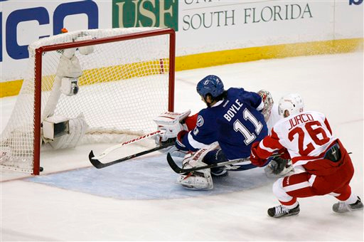 . Detroit Red Wings goalie Petr Mrazek is beaten for a goal by Tampa Bay Lightning center Brian Boyle (11) as Red Wings right wing Tomas Jurco (26) defends during Game 1 of an NHL hockey first-round playoff series, Thursday, April 16, 2015, in Tampa, Fla. (Douglas R. Clifford/Tampa Bay Times via AP)