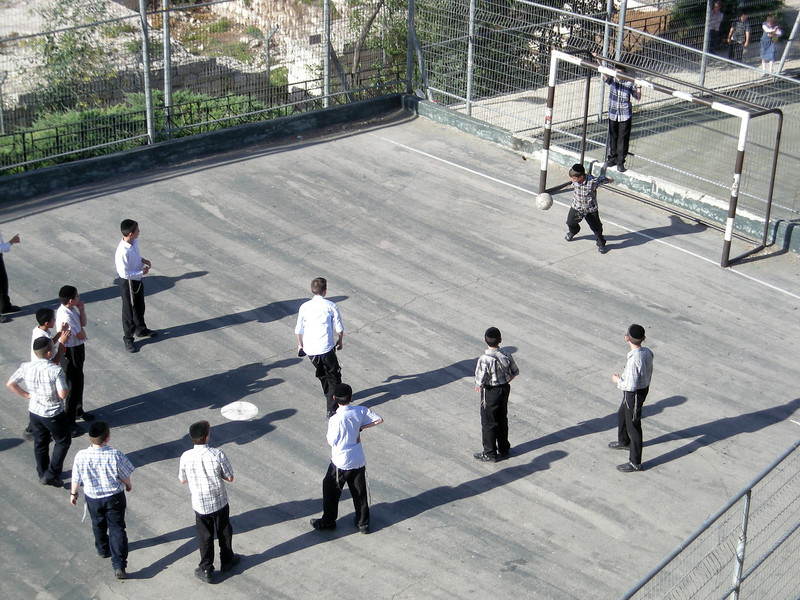 protecting the goal, kids playing in the Jewish Quarter.