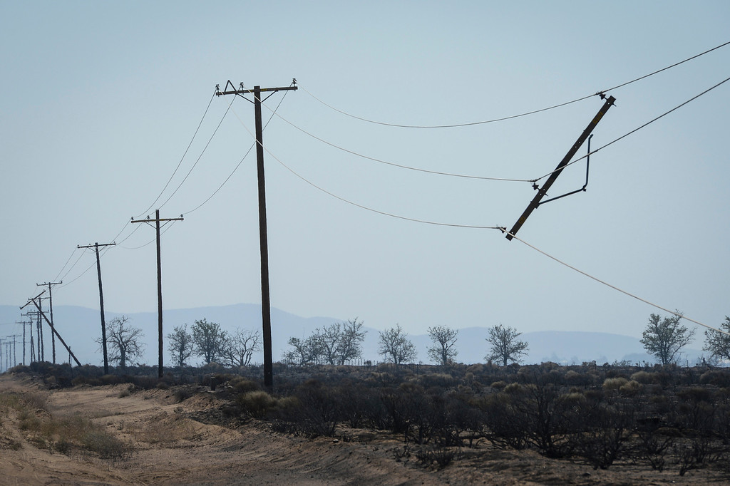 . Damaged power lines along Lancaster road which were burned in the Power House fire.   Photo by David Crane/Los Angeles Daily News