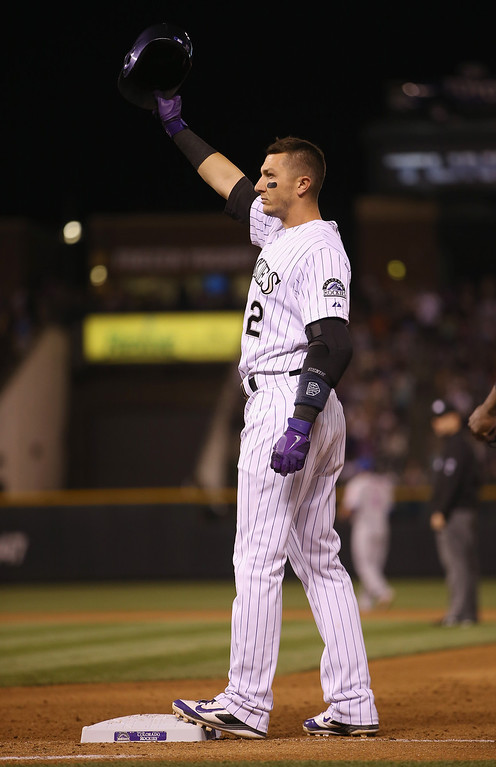 . DENVER, CO - MAY 03:  Troy Tulowitzki #2 of the Colorado Rockies acknowledges the fans after hitting his 1000th career hit, a single off of relief pitcher Daisuke Matsuzaka #16 of the New York Mets in the seventh inning at Coors Field on May 3, 2014 in Denver, Colorado.  (Photo by Doug Pensinger/Getty Images)
