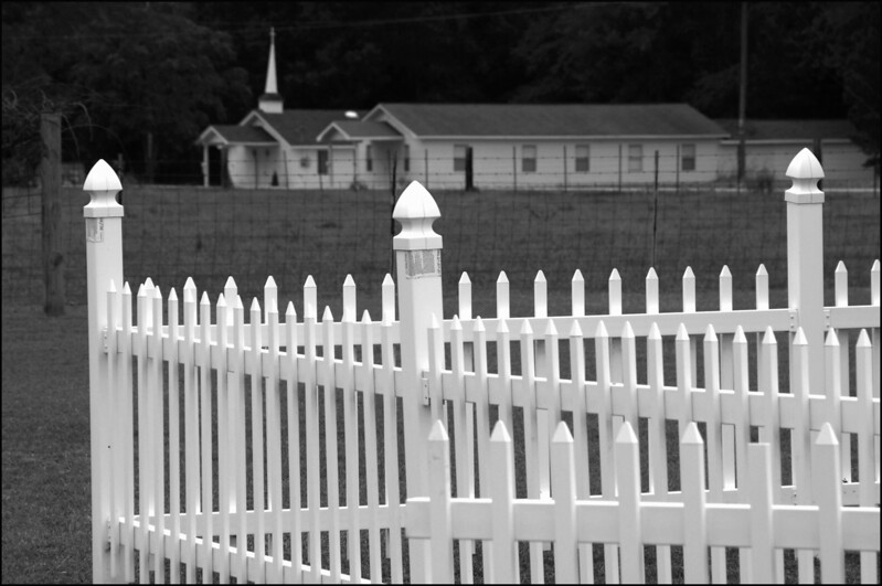 White Fence with a Church