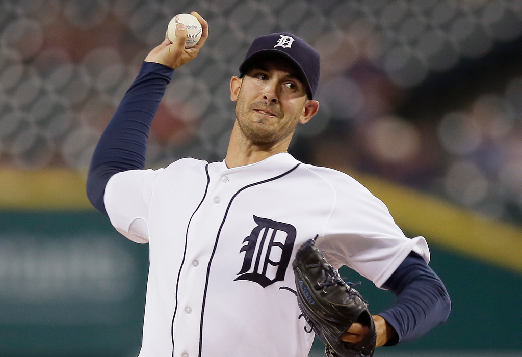 . Detroit Tigers starting pitcher Rick Porcello throws during the first inning of a baseball game Kansas City Royals in Detroit, Wednesday, Sept. 10, 2014. (AP Photo/Carlos Osorio)