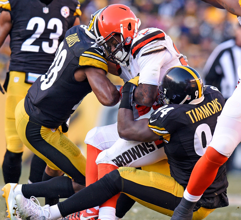 . Cleveland Browns running back George Atkinson is tackled by Pittsburgh Steelers inside linebacker Lawrence Timmons (94) and strong safety Sean Davis (28) during the second half of an NFL football game in Pittsburgh, Sunday, Jan. 1, 2017. (AP Photo/Don Wright)