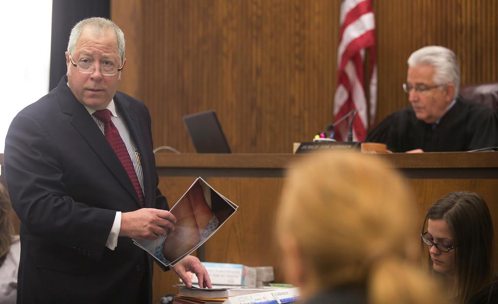 . Michael Allen Blair/MBlair@News-Herald.com Defense attorney Michael J. Connick reviews photographic evidence of Sabrina Zunich during Kevin Knoefel\'s murder conspiracy trial in Lake County Common Pleas Court on  June 3, 2014.